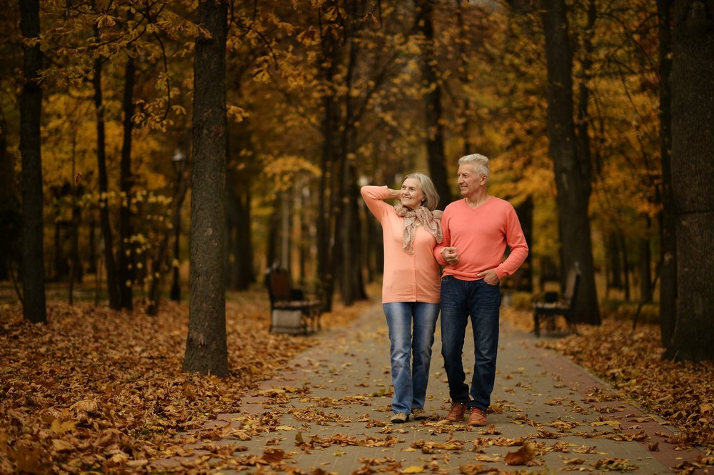 elderly couple contemplating care home costs